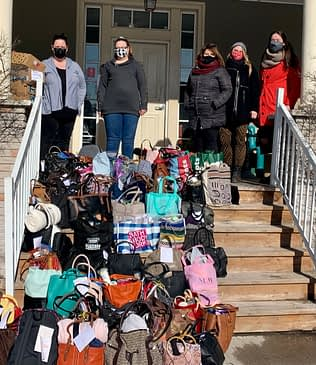 4th Line Theatre Staff Drop-off Purse Project Donations to Cameron House...